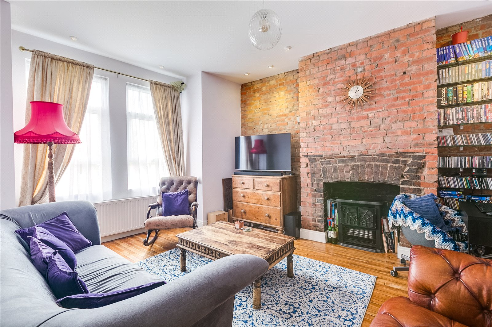 living room with exposed brick walls